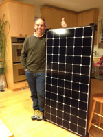 Christopher with a 240W Sunpower E19 Panel